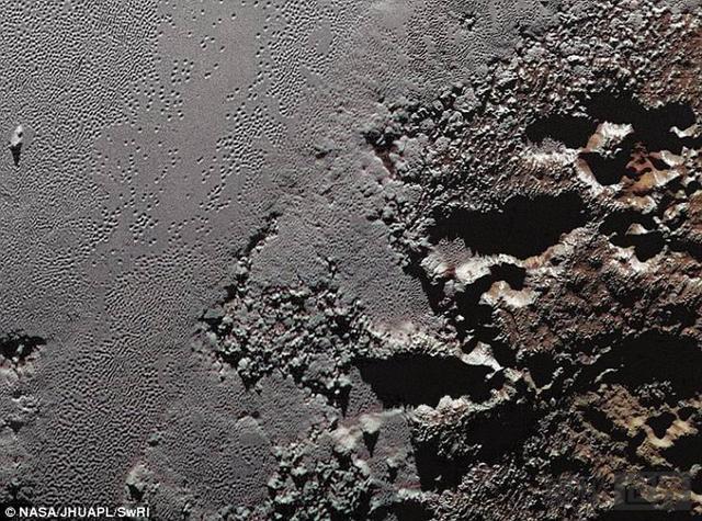 冥王星冰层表面之下可能隐藏着液态海洋